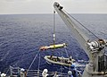 US Navy 090828-N-2638R-002 A MK-46 recoverable exercise torpedo (REXTORP) is hoisted aboard the guided-missile destroyer USS Mustin (DDG 89) during a REXTORP exercise.jpg