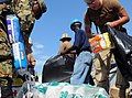 US Navy 100127-N-1831S-092 U.S. Navy Sailors assigned to Beach Master Unit (BMU) 2, and Mexican navy sailors transport baby supplies to the Killick Haitian Coast Guard Base.jpg