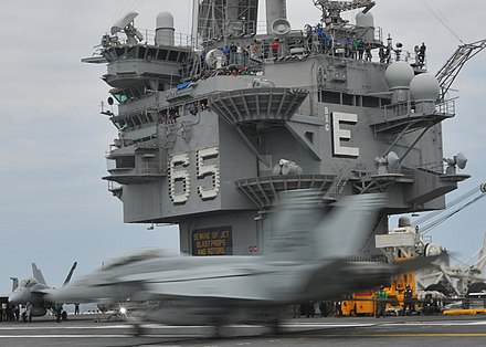 Island control structure of USS Enterprise US Navy 100512-N-8446A-004 An F-A-18F Super Hornet assigned to the Fighting Checkmates of Strike Fighter Squadron (VFA) 211 lands aboard the aircraft carrier USS Enterprise (CVN 65).jpg
