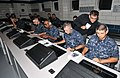 US Navy 100916-N-8848T-351 Dr. Talib Hussain, senior scientist at BBN Technologies, looks over the shoulder of a recruit during a training session.jpg