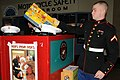 US Navy 101201-N-2143T-002 Pfc. Eric Tanis puts toys in a collection box to support the Marine Toys for Tots foundation.jpg
