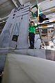US Navy 110514-N-1004S-108 Sailors install an antenna onto the left vertical stabilizer of an F-A-18E Super Hornet.jpg