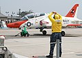 US Navy 110601-N-ZZ999-001 Aviation Boatswain's Mate 3rd Class Dennis Lopez, left, secures a T-45C Goshawk to the Electromagnetic Aircraft Launch S.jpg