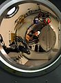 US Navy 110928-N-BA263-022 Navy Diver 2nd Class Daniel Grace role-plays as a patient during a recompression chamber supervisor drill.jpg