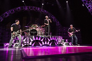 Van Halen performing in 2015. From left to right: Wolfgang Van Halen, Alex Van Halen, David Lee Roth, and Eddie Van Halen.