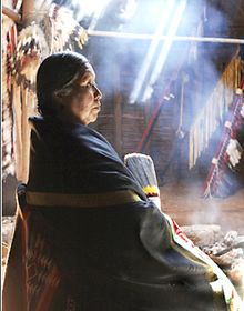 photograph of Vanessa Jennings taken in 1989 inside her earth lodge