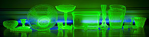 Uranium glass - Various Vaseline glassware glowing under a few UV black lights