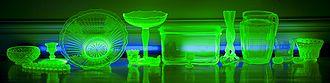 Uranium glass - Various Vaseline glassware glowing under a few UV black lights