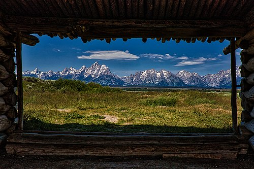 Looking through the Cunningham Cabin in Grand Teton National Park, by Abu Sufian Mohammad Asib.