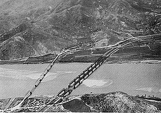 Hill 303 massacre - The Waegwan Bridge (collapsed) crossing of the Naktong River. Hill 303 is visible on the bottom right.