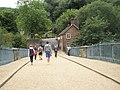 Walking down the Iron Bridge towards the Toll House - geograph.org.uk - 1466912.jpg