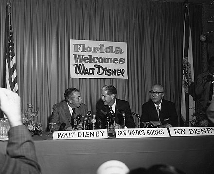 Walt Disney (left) with his brother Roy O. Disney (right) and then-governor of Florida W. Haydon Burns (center) on November 15, 1965, publicly announcing the creation of Disney World Walt Disney with Company at Press Conference.jpg