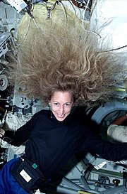 Astronaut Marsha Ivins demonstrates the effect of weightlessness on long hair during STS-98