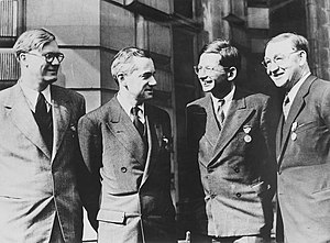 James Chadwick - Key British physicists. Left to right: William Penney, Otto Frisch, Rudolf Peierls and John Cockcroft. They are wearing the Medal of Freedom.