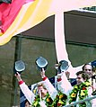 Winners Hurley Haywood, Mauro Baldi & Yannick Dalmas on the podium at the 1994 Le Mans (31130244344) (2).jpg