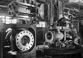Cameron International - Worker machining hole flange, Cameron Iron Works, Houston, 1948