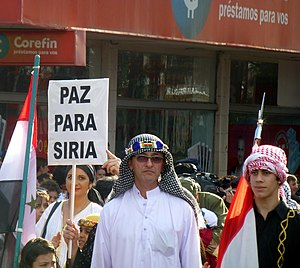 "Syrian Argentines - ""Paz para Siria"" (Peace for Syria, in Spanish), the message of the Arab Argentine community during the opening parade of the XXXIV National Immigrant Festival in Oberá, Misiones."