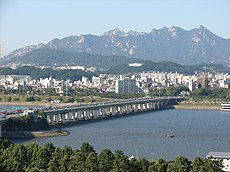Yanghwa Bridge, facing north. Bukhansan is in the background