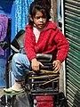 Young Girl on Motorbike - Darjeeling - West Bengal - India (12406123233).jpg