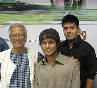 Social entrepreneurship - Grameen Bank founder and Nobel Peace Prize winner Muhammad Yunus (left) with two young social entrepreneurs (right).