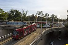 Z3 219, 128, and Z2 114 (Melbourne trams) at St Kilda Junction, 2013.JPG