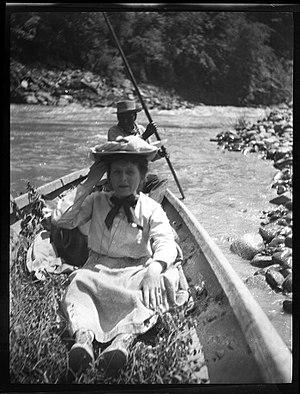 """Grace Nicholson - Image: """"Canoe & occupants, en route, Trinity,"""" 1906. Grace Nicholson is in front"""