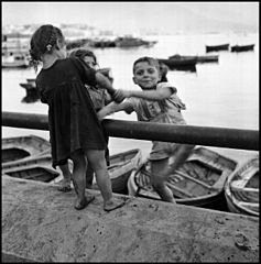"""Children In Naples, Italy"". Children playing. Photographed by Lieutenant Wayne Miller, July 1944. U.S. Navy Photograph, now in the collections of the National Archives.jpg"