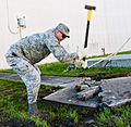 116th Civil Engineering Squadron repair drainage problem 130413-Z-XI378-001.jpg