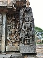 12th-century Shiva with Parvati in lap and a musician at Shaivism Hindu temple Hoysaleswara arts Halebidu Karnataka India.jpg