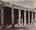 1870 photo of Hindu temple column ruins in the colonnade of the Quwwat-ul-Islam Mosque at the Qutb, Delhi.jpg