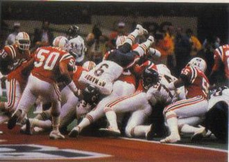 1985 NFL season - The Bears making a rushing play in the end zone against the Patriots during Super Bowl XX.