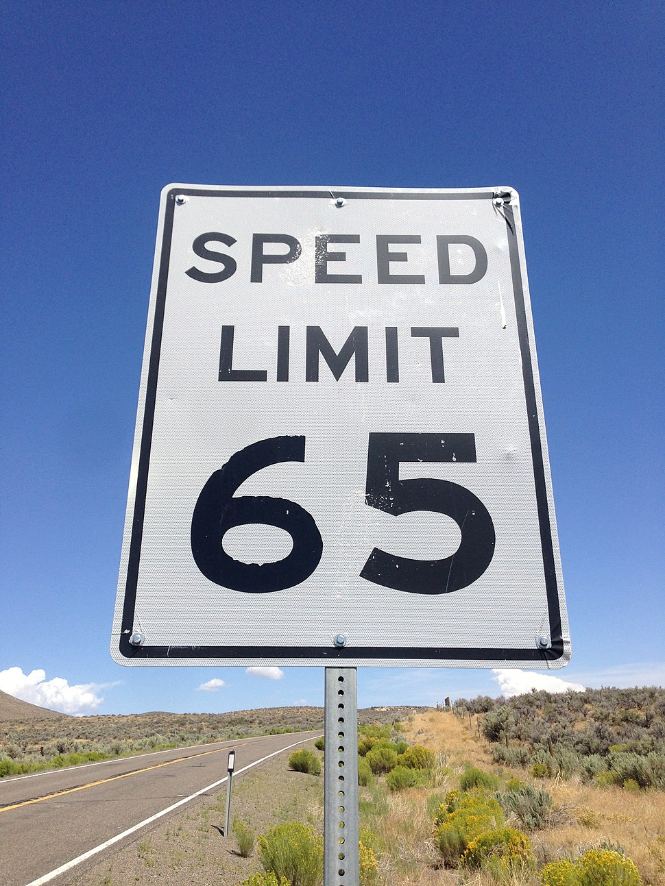 2014-08-19 11 59 11 Speed limit 65 miles per hour sign along northbound Nevada State Route 225 (Mountain City Highway) about 10.9 miles north of Nevada State Route 535 (Idaho Street) in Elko County, Nevada
