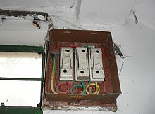 distribution board a three phase service drop enters through the side of this main service panel consisting of three 100 ampere fuses