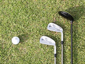 English: 3 golf clubs and ball at Wakasu Golf ...