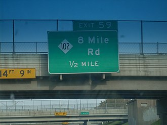 M-102 (Michigan highway) - 8 Mile Road exit sign on I-75, at 7 Mile Road in Detroit