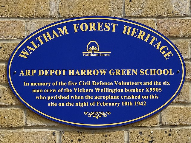 Blue plaque № 9679 - ARP depot Harrow Green School - In memory of the five local Civil Defence volunteers and the six man crew of the Vickers Wellington bomber X9905 who perished when the aeroplane crashed on this site on the night of February 10th 1942