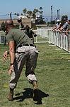 A Marine volunteer with the Single Marine Program plays dodge ball during a Big Marine Little Marine event.jpg