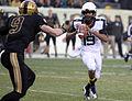 A Navy quarterback scrambles..jpg