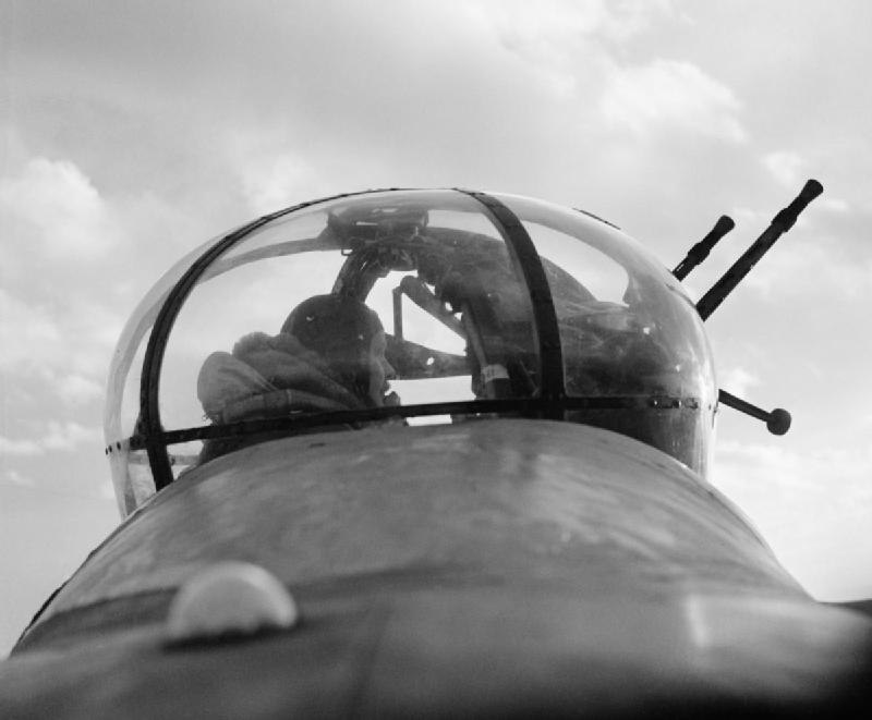 A No. 57 Squadron Lancaster mid-upper gunner in his turret, February 1943. CH8795