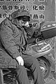 A man is sleeping on a motorbike.jpg