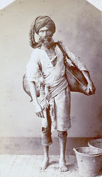 """Water carrier - A water carrier or """"bhisti"""" in India,"""