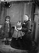 A woman and two girls NLW3364710.jpg