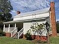 Aaron and Margaret Parker Jr. House front side showing porch and traveler's room.jpg