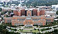 Aerial view of the Clinical Center (Building 10), NIH Campus, Bethesda, MD (20384488641).jpg