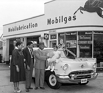 The Negro Motorist Green Book - An African-American family with their new Oldsmobile. Washington, D.C., April 1955