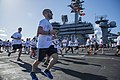 Ailors and tiger cruise participants run aboard USS Carl Vinson. (18424862791).jpg