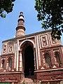 Alai Darwaza seen under the towering Qutub Minar.jpg