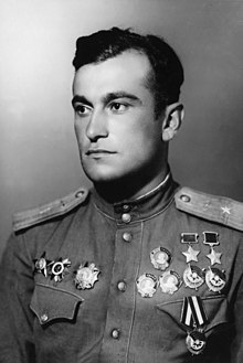 1945 postwar portrait of Amet-khan Sultan in uniform, wearing his two hero of the Soviet Union medals, three orders of lenin and three orders of the red banner on one side of his chest (right side in photo, left in life) and his Order of the Red Star, Order of the Patriotic War, and Order of Aleksander Nevsky on the other side.