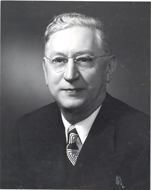 Portrait photo of Andrew B. Turnbull wearing a suit and tie