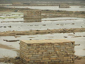 Nan'an, Fujian - An aquaculture establishment in Anhai Bay, near Shijing Town. Note the use of the local stone for construction.